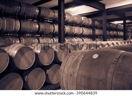 Aged photo of old cellar with  barrels