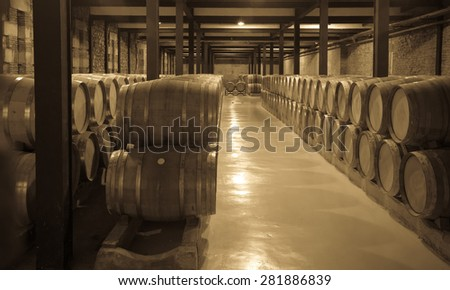 Aged photo of old winery  with wine barrels  - stock photo