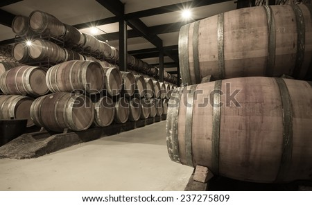 Aged photo of winery with  many wooden barrels  - stock photo