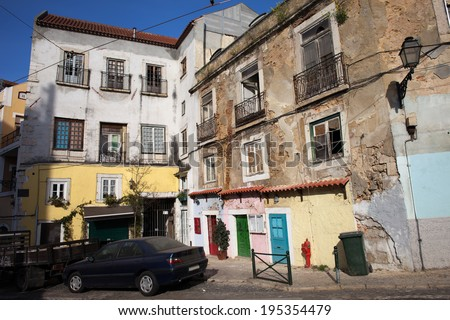 Aged picturesque houses in historic district of Alfama in the city of Lisbon, Portugal.