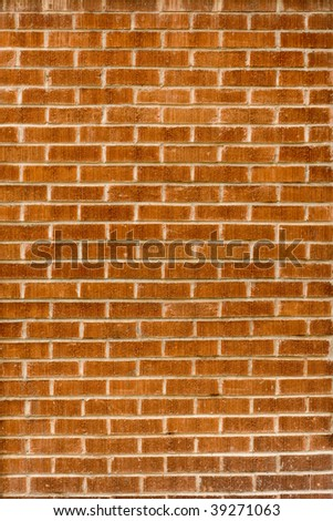 Aged red brick wall - stock photo