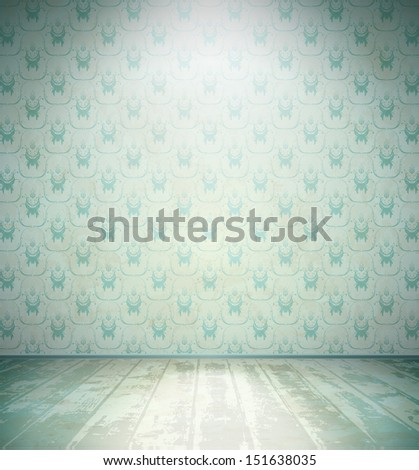 Aged room with wooden floor and floral wallpaper - stock photo