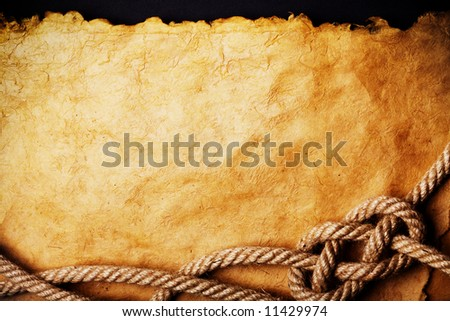 aged Rope on the old paper background - stock photo