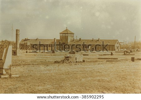 Aged sepia digital grunge distressed effect auschwitz concentration camp. - stock photo