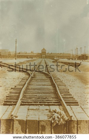 Aged sepia digital grunge distressed effect Auschwitz concentration camp.