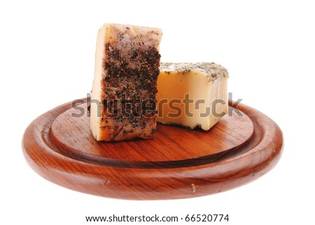 aged smoked cheese in pepper on wood