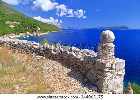Aged stone wall above the Adriatic sea coast, Croatia - stock photo