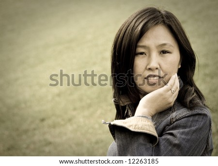 Aged style portrait of young attractive woman outdoors. You can use left part as copyspace.