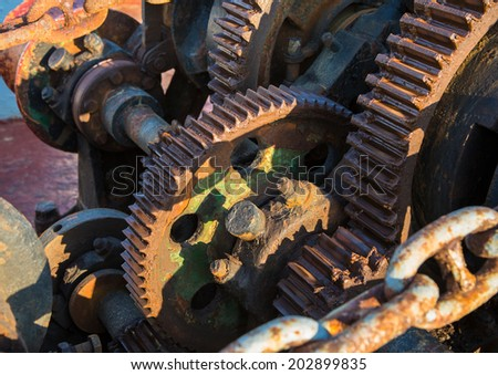 Aged technology: Old and rusty gearwheel on an old ship - retro and vintage look. - stock photo