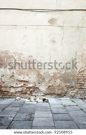 Aged textured street wall background - stock photo