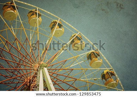 aged vintage photo of carnival ferris wheel with toned f/x - stock photo