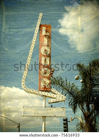 aged vintage photo of liquor store sign - stock photo