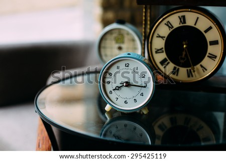 aged vintage retro clocks on the table perfect for business, education or other time concept quotes background natural light - stock photo