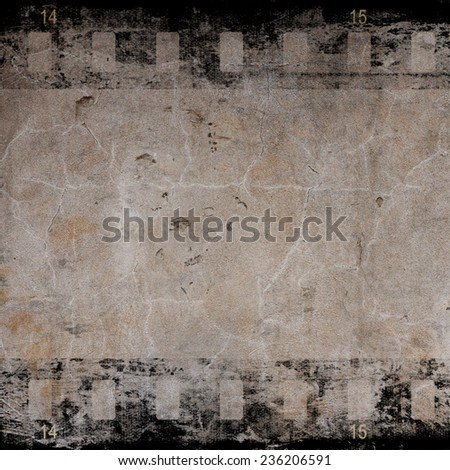Aged wall with film strip       - stock photo