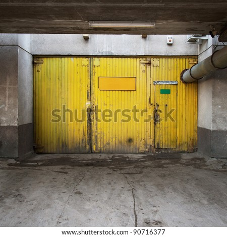 Aged warehouse exterior with doors. - stock photo