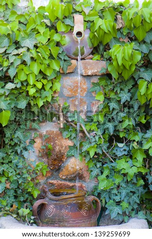 Aged water fountain - stock photo