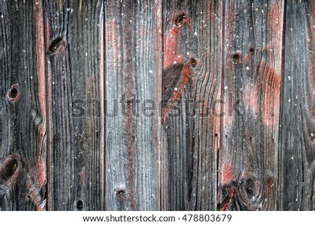 Aged weathered wood with nails, cracks and knots.