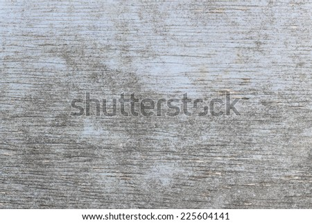 Aged wooden background of weathered distressed rustic wood with faded light blue paint showing woodgrain texture - stock photo