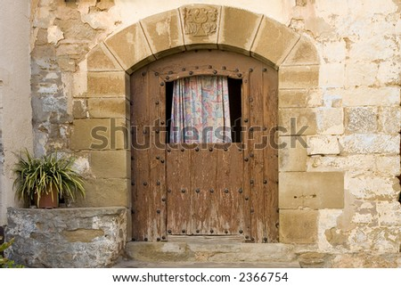 Aged wooden door in an ancient house