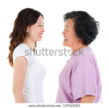 Ageing concept. Asian senior mother and adult daughter face to face, profile side view smiling isolated on white background. - stock photo
