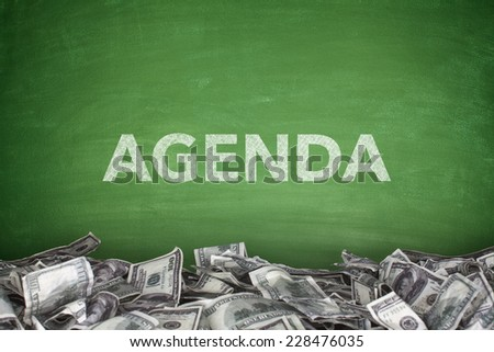 Agenca on blackboard with businessman hand holding chalk - stock photo