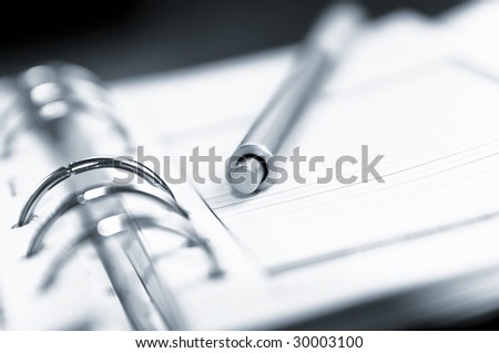 agenda and ball pen - stock photo