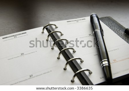 Agenda and Pen - stock photo