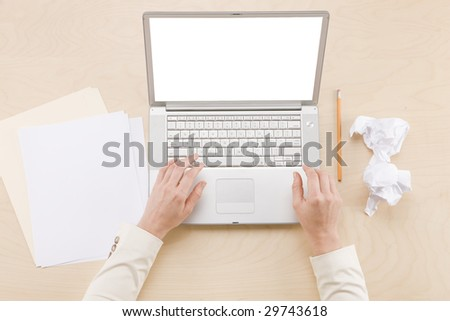 Agenda for the day  - overhead shot of hands using laptop - stock photo