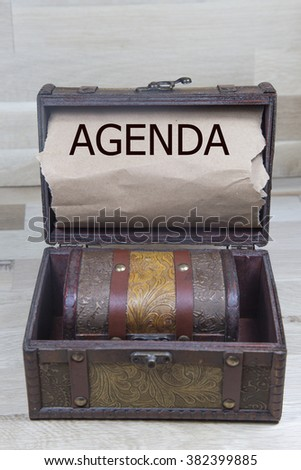 agenda is written on the Brown torn paper in the treasure box