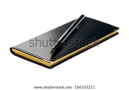 Agenda. Scheduling. Organizer and fountain pen (closeup shot, shallow DOF) isolated on white. - stock photo