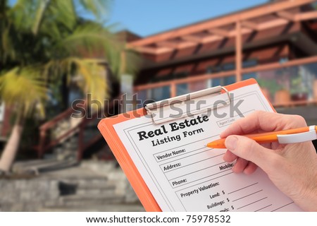 Agent Completes a Real Estate Listing outside a House - stock photo
