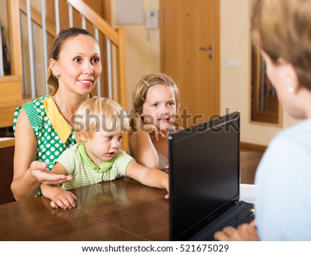 Agent consulting smiling mother with two kids about insurance