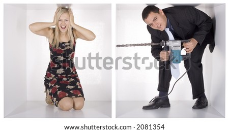 agent drilling whole in the white cube to spy blonde businesswoman - stock photo