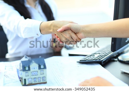 agent shows a build project to a client - stock photo