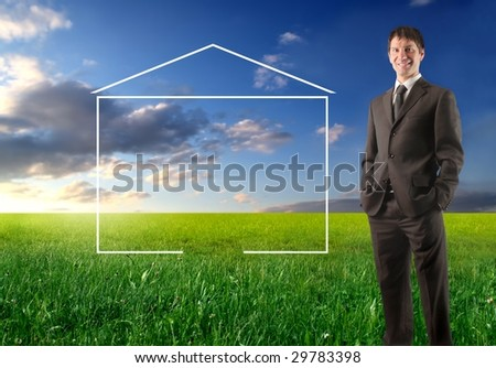 agent standing in a grass field with an illustration of an home - stock photo