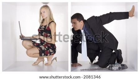 agent watching blonde businesswoman throw whole in the cube - stock photo