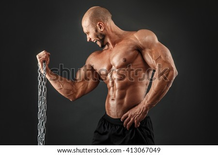 Aggressive bodybuilder with metal chain.Isolated