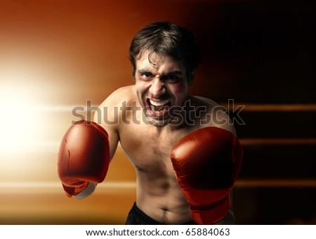 Aggressive boxer on a ring - stock photo