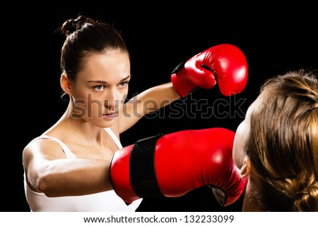 Aggressive boxing woman, hits an opponent in the head