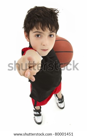 Aggressive boy child basketball player up close pointing in face over white.