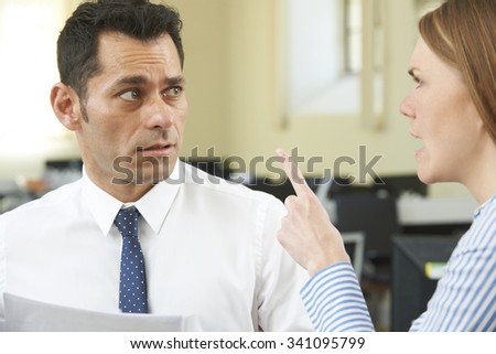 Aggressive Businesswoman Shouting At Male Colleague - stock photo