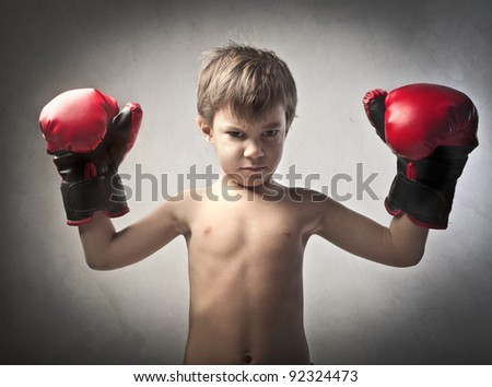 Aggressive child disguised as a boxer - stock photo