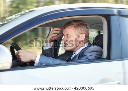 Aggressive driver behind the wheel of a car