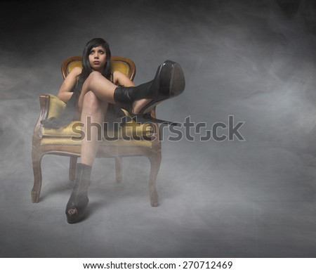 aggressive heels in a cloud and fog room - stock photo