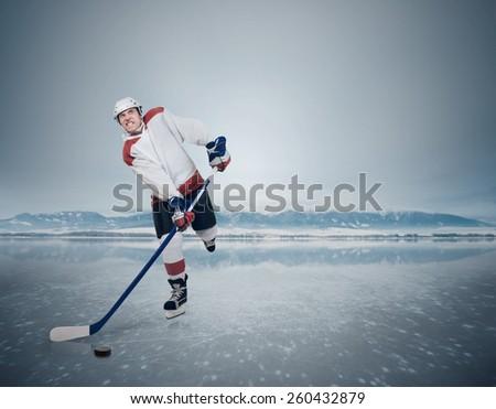 Aggressive Hockey player on the frozen Lake  - stock photo
