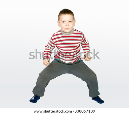Aggressive little boy on a combined background - stock photo