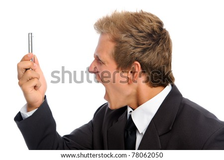 Aggressive man in business suit shouting into his cell phone - stock photo