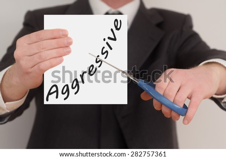Aggressive, man in suit cutting text on paper with scissors