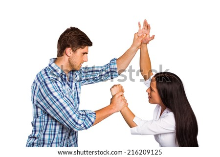 Aggressive man overpowering his girlfriend on white background - stock photo