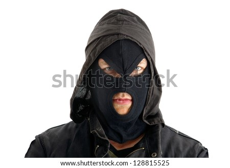 Aggressive masked figure ready to commit crimes - stock photo